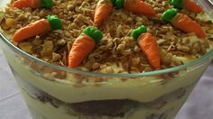 Carrot cake trifle made with vanilla pudding, toasted almonds and coconut, and toffee bits is a fun twist on the traditional carrot cake.