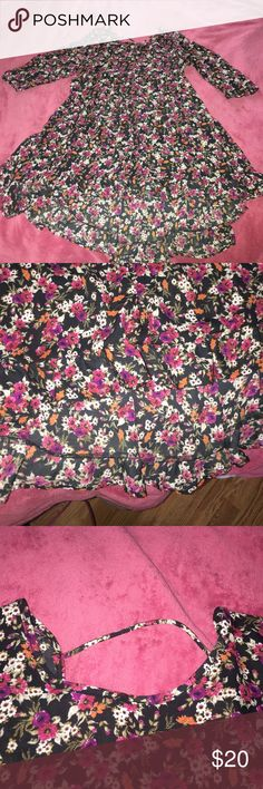 Floral Dress Floral dress or top depending how you wear it (I wore it as a dress I'm 5'3). Only worn once or twice. Quarter sleeves. Line going across the upper back. Flowy on the bottom. Dresses Mini