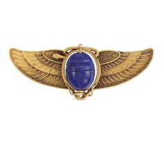 Egyptian Revival Gold and Lapis Scarab Brooch -  Centering a rotating oval lapis scarab approximately 18.8 x 14.8 x 10.6 mm., surrounded by a gold serpent, flanked by finely detailed gold wings, circa 1870, approximately 17.6 dwts.
