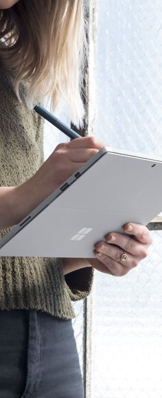 The new desk is a standing one - ready whenever inspiration strikes. The new Microsoft Surface Pro.