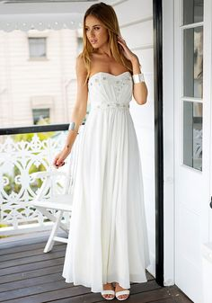 Look like a princess in this beaded sweetheart prom dress which features sweetheart neckline, a side zipper closure and padded cups.   Lookbook Store Dress