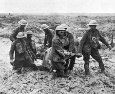 Stretcher bearers mired in mud in the Third Battle of Ypres - August 1, 1917