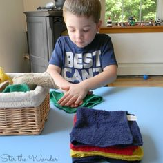 Teaching toddlers and preschoolers to fold towels is a simple practical life skill they can easily learn with a Montessori Inspired Towel Folding Activity. Montessori Toddler Rooms, Montessori Kindergarten, Montessori Education, Toddler Learning Activities, Montessori Materials, Montessori Activities, Toddler Preschool, Teaching Kids, Montessori Practical Life