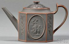Wedgwood Black Basalt teapot and cover, England, early 19th century, octagonal shape with bead-framed classical medallions