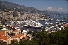 Yachts pull in to harbor to watch the Monaco Grand Prix on practice day.