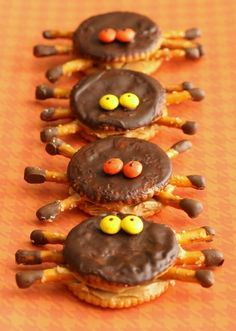 Ritz cracker spiders    or could just make a peanut butter cracker sandwich, insert 4 thin pretzil stick 1/2s into each side and top with 2 raisins dipped in cream cheese (lojollamom.com)
