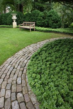 awesome salvaged brick border with substantial width to make it a feature. Pachysandra always a great idea.