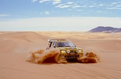 dequalized:  A 1987 Peugeot 205 Turbo 16 plowing through the desert sand during the Rallye Paris-Dakar. Photo by Peugeot Sport.