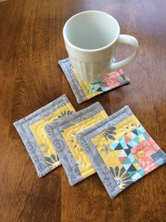 Gray, yellow, white, aqua & peach log cabin quilted coasters, set of 4 - reversible