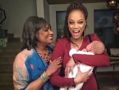 Model Tyra Banks celebrating her first mother's day. | essence.com