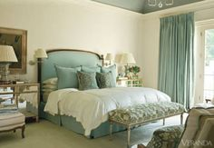 To keep patterns from overwhelming a tranquil teal bedroom, this designer uses them judiciously. Headboard by Dennis & Leen, bedskirt, large pillows and curtains, all in Florio Collection linen. Pillows in Sabina Fay Braxton velvet. Linens, Susan Shepherd. Bench, Nancy Corzine, in Cowtan & Tout fabric. Chests, Panache Designs. Wall lamps, Jasper. Carpet, Helios. Image originally appeared in the January/February 2011 issue of VERANDA. INTERIOR DESIGN BY SUZANNE KASLER