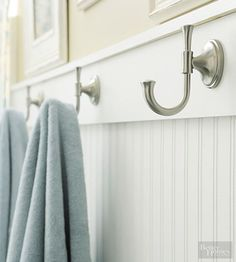 Relatively easy to install, beaded-board panels provide a fetching foundation for beach-style bathrooms. Cap the wainscoting with flat trim pieces that provide a Craftsman finish and allow room for nautical, anchor-like towel hooks.