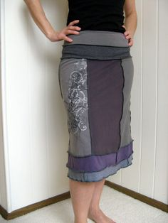 Turnaround Designs upcycled tshirt skirt. I see a lot of people on Etsy do this. But need a serger to do it with. :( Maybe some way to do it with a special sewing machine foot or something?