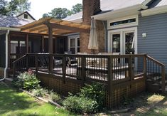 This TimberTech deck in Columbia is built using decking from the Timbertech Edge collection in the Tidal Sand color. The project also includes a wooden overhead pergola and a spacious screened porch. Deck Builders, Outdoor Spaces, Outdoor Decor, Decking, Columbia, Porch, Pergola, Backyard, Building