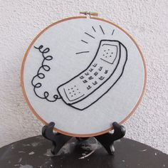 "Hoop Art ""Call Me"" • Embroidered Retro Phone • Embroidery Wall Hanging / Home Decor • 7"" Hoop Frame by loudmouthmarket on Etsy https://www.etsy.com/listing/475999855/hoop-art-call-me-embroidered-retro-phone"