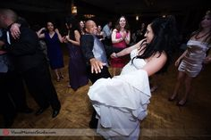 Bride having fun at Anthony's Pier 9  by Visual Masters.jpg