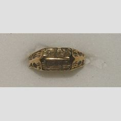 'Iconographic' ring  England  15th century  Gold iconographic ring, the double bezel engraved on one side with the Trinity and on the other St.Barbara; inside is a black letter inscription EN BON AN  16.71 mm internal ring diameter; 4.47 g weight
