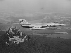 A CF-104 Starfighter of Canada's NATO-assigned No. 1 Air Division flies over Hohenzollern castle in the Federal Republic of Germany. The Air Division was equipped with six squadrons of the jet aircraft and was based in Germany when this photo was taken circa 1969. PHOTO: DND