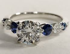 I like this, but would want the center gem a little smaller,  with sapphires and diamonds reversed (or two shades of gemstones)