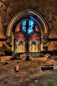 Beautiful stained glass window in an abandoned cathedral