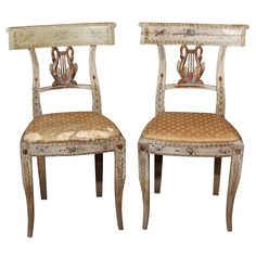Pair of Italian classical style painted and gilded chairs.