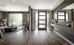 The blank space of a hallway leaves it wide open for your creativity. A mirror on the wall creates a larger roomy feel.  See this in our Windermere display at Googong.  For more info visit : http://www.rawsonhomes.net.au/display-locations-overview.php
