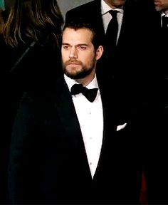 GIF: Henry Cavill attends the EE British Academy Film Awards at the Royal Opera House, Bow Street in London.