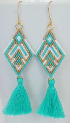 Excited to share the latest addition to my #etsy shop: Brick Stitch Earrings with Tassel charm-silver,turquoise, gold, and white miyuki delica seed beads,22k gold filled earwire #victoriasdesignus #brickstitch #tasselearrings #tassellove #jewelry #earrings #turquoise #boho #earwire #gold #girls #triangle #beadedearrings