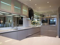 Mirror splashbacks are a great way to add a touch of glamour to kitchen. The reflection also helps to add a sense of space to a room. #mirror #Splashback