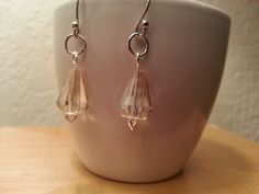 Platinum and crystal earrings.
