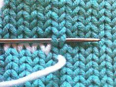 Using a duplicate stitch on the wrong side to weave in yarn ends...the yarn end is nearly invisible on the right side of the work and, just as importantly, stays where you put it!