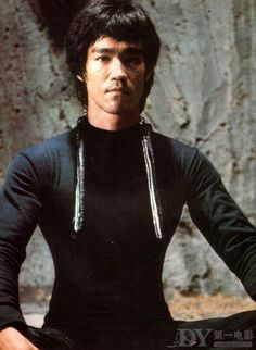 bruce lee a macho swan.A King David of men.Philosopher and martial arts innovator. 2 swans kissing make a heart symbol.