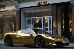 A Gold Ferrari sits outside Chanel on Sloane Street in London. Tourists and car enthusiasts have been flocking to the wealthy London district to see some of the world's most expensive and extravagant super cars. Many of the rich owners from Saudi Arabia and Kuwait come to London to escape the summer heat at home and to show off their cars before moving on to other European cities such as Paris and Cannes. (Picture: Dan Kitwood/Getty Images)