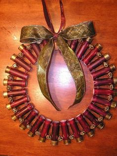 Shotgun shell wreath if I made this Nate might let me decorate for Christmas ; Holiday Crafts, Holiday Fun, Christmas Time, Christmas Wreaths, Christmas Bulbs, Christmas Decorations, Redneck Christmas, Xmas, Merry Christmas