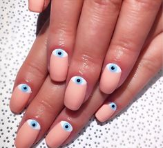These tiny little evil eyes. | 25 Times Nail Art Blew Your Mind In 2015