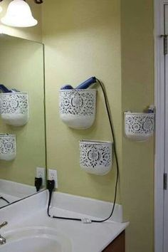 Find unexpected storage options in your small bathroom! Try using a wine rack for rolled towels, choose a mirror that has hidden storage, use adhesive hooks to hang flat irons or curling irons, and repurpose plant holders for easy wall storage. These tips Organizing Ideas, Organization Hacks, Storage Hacks, Makeup Storage, Hair Tool Storage, Hair Dryer Storage, Organizing Clutter, Diy Hair Dryer Holder, Hair Appliance Storage