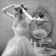 1951 Vogue US   corset with garters and crinolines