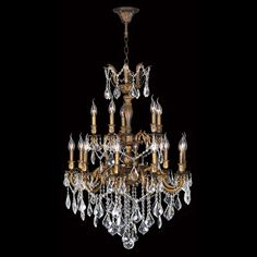 This elegant antique bronze chandelier features timeless brass and crystal construction. The chandelier features 15 lights to illuminate your home in brilliant style.