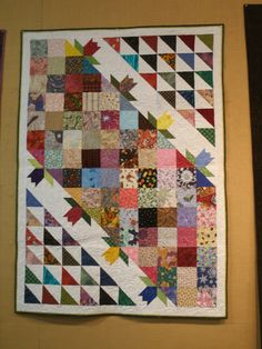 It's been just over a month since I posted the tutorial for a tulip block made from Thrifty Quilter pieces. (click HERE to re-read that post.) Today seems like a good time to plant My Tulip Garden:...