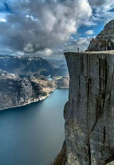 Exploring the top of the world at Preikestolen, also known as the Pulpit Rock, is a steep cliff in Forsand, Ryfylke, Norway.