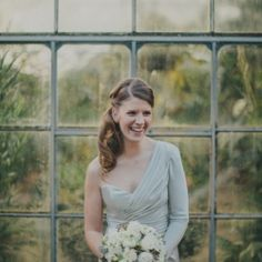 With her one-shouldered silver wedding gown and her low side ponytail, this Australian bride has some serious style!