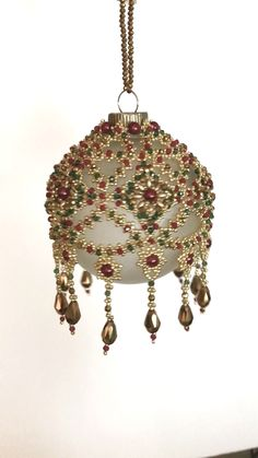 "Tutorial available for ""Christmas Carousel "" - kugeln - Artesanato Beaded Christmas Decorations, Beaded Christmas Ornaments, Handmade Christmas, Christmas Crafts, Handmade Ornaments, Felt Christmas, Beaded Ornament Covers, Beaded Crafts, Jewelry Crafts"