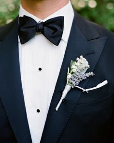 Lily of the valley, lamb's ear leaves, and lavender and rosemary sprigs adorned the groom's lapel.