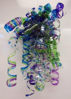 Chihuly Sculpture from Water Bottles! Something like this?? only not so much! and them going all which ways in like red and green!! or gold and white?