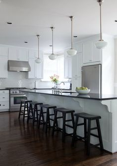 SallyL: Beth Haley Design - Gorgeous black and white kitchen with extended kitchen island. White ...