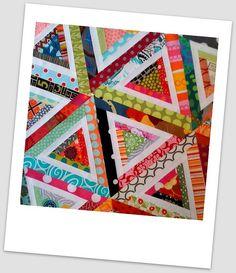 Scrappy log cabin triangles by Lynne @ Lilys Quilts, via Flickr