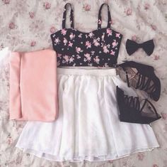 cute black crop top with pink roses and the high wasted off white skirt. Adorable!