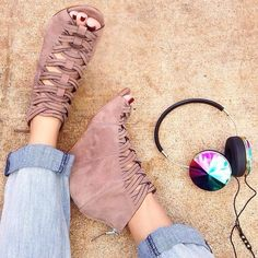 Catch some air in these peep toe wedge booties!