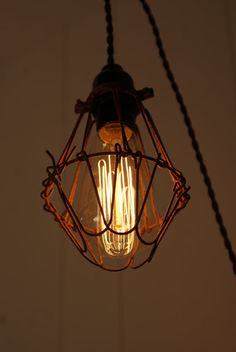 Good use of pulley NICE DISCLAIMER!    .......Hey, I found this really awesome Etsy listing at https://www.etsy.com/listing/122780967/hanging-industrial-cage-light-lamp-with