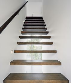 see-through staircase; the basic house has under-staircase storage, which is more practical but less beautiful.